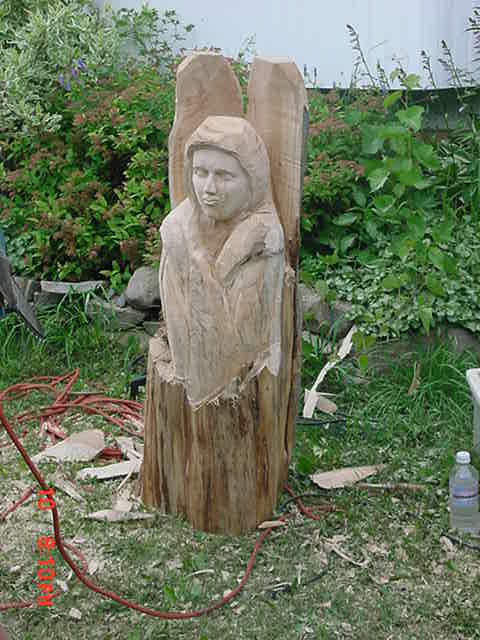 Chainsaw carving an angel at joe s place carver kings